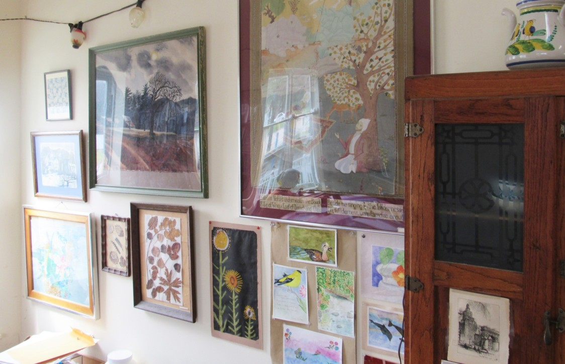 A collection of prints, paintings, and photographs hang above Darr's kitchen table. Photo by Avery Gregurich.