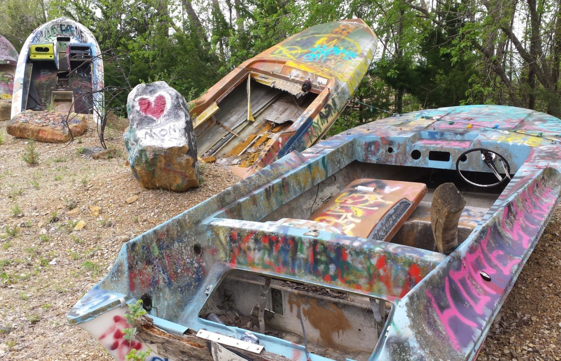 Lessman encourages patrons to bring spray paint and put their name or a message on the boats. His goal is to exceed Cadillac Ranch in Texas, where the paint is said to be two inches thick.