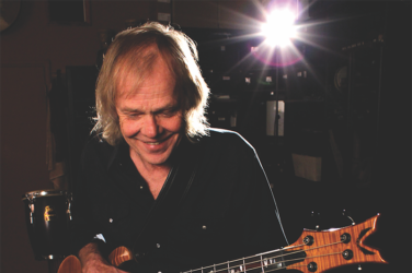 Stephen Jay holding electric bass