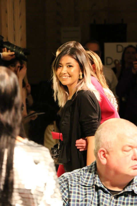 Munisa Khuramova is all smiles on the end of the runway with the model closing the show.