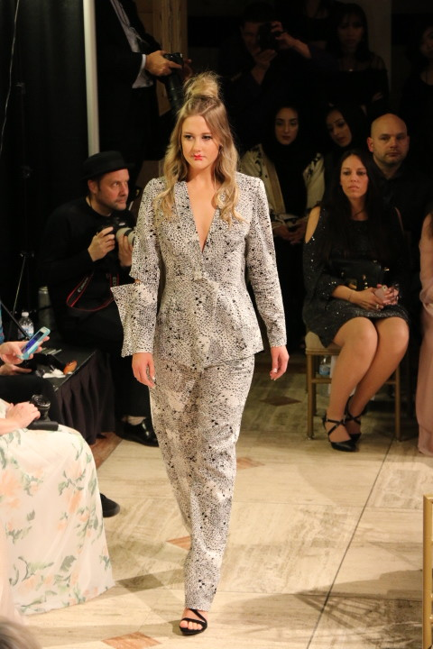 For her closing look, Amanda Casarez chose this geometric black-and-white suit.