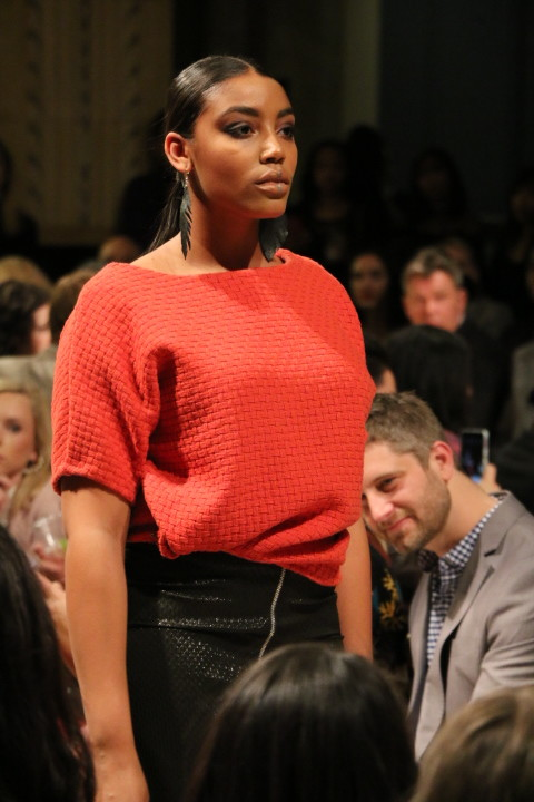 A model from Barbara Bultman's collection shows off a vivid red top and sleek zippered skirt.