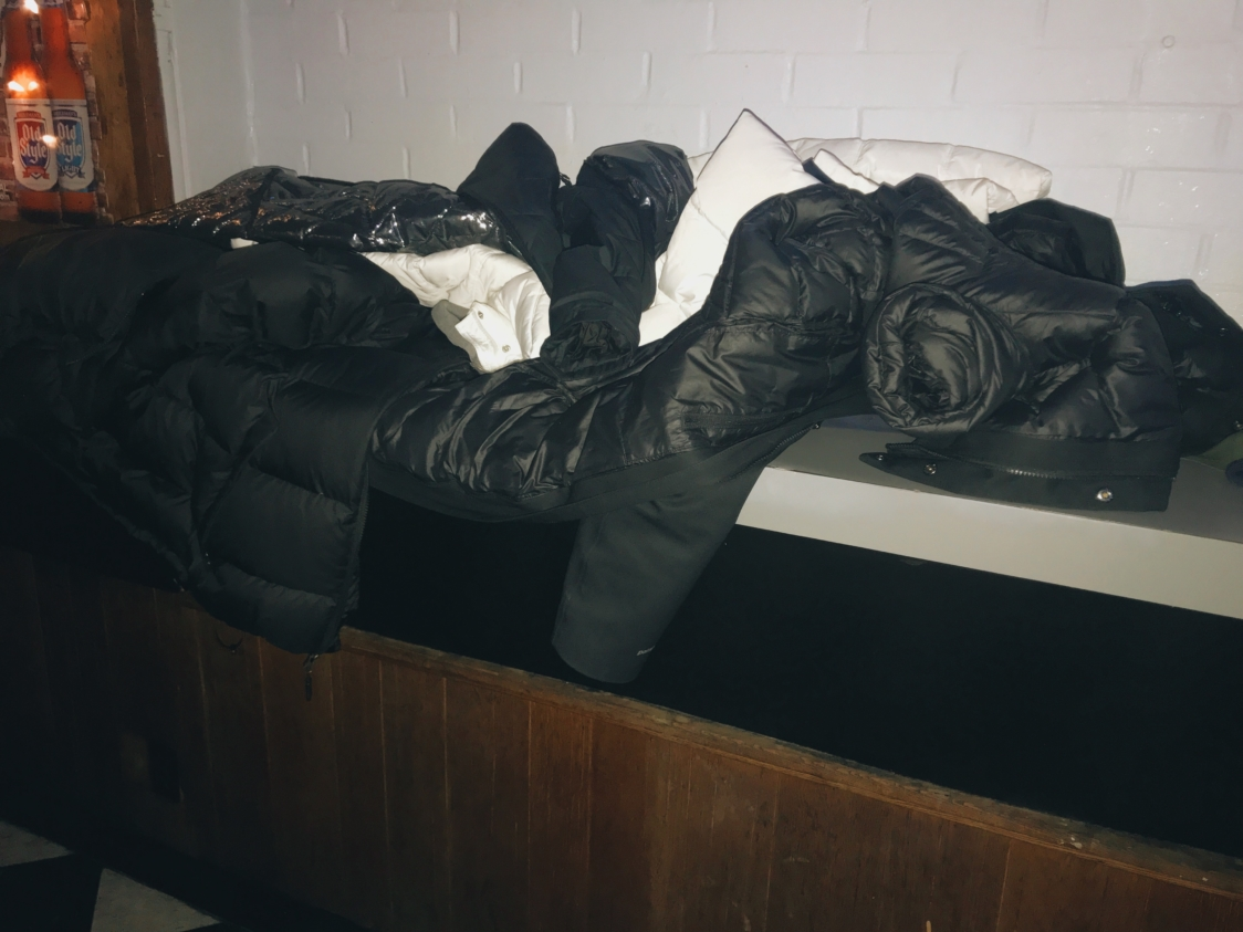 Coats were also stacked on a counter in the back of the bar where there was less foot traffic