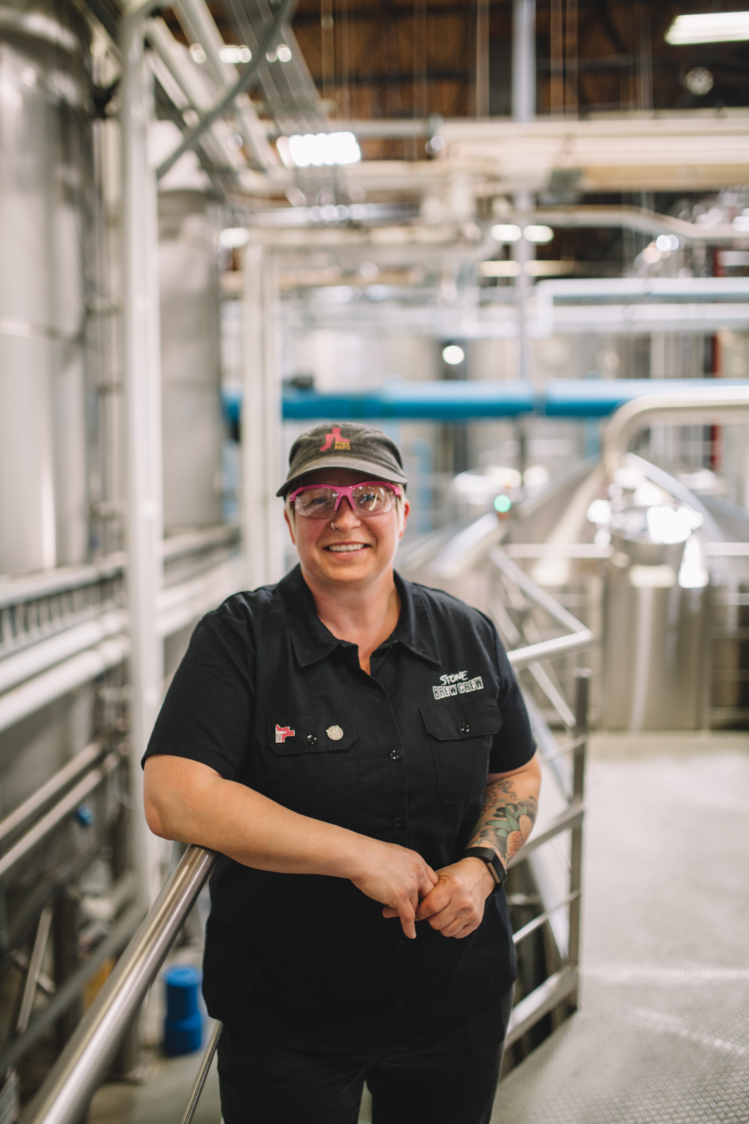 Laura Ulrich, President of Pink Boots Society poses in a brewery