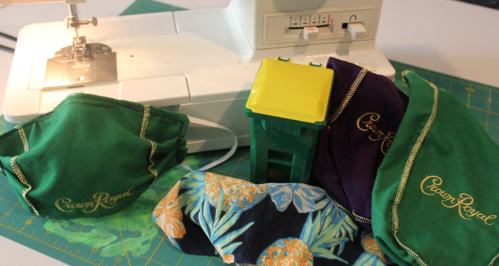 sewing machine, crown royal bags, material, and mini garbage can