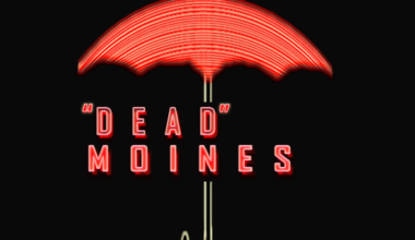 """The words """"Dead Moines"""" displayed under the Travelers insurance umbrella"""