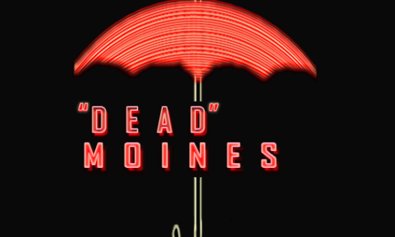 "The words ""Dead Moines"" displayed under the Travelers insurance umbrella"