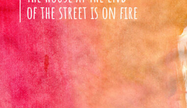 Text in the top left corner of a red and orange watercolor page reads, the house at the end of the street is on fire.